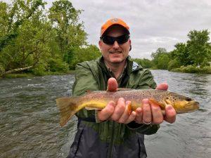 Man in Orange Hat Holding a Fish 2