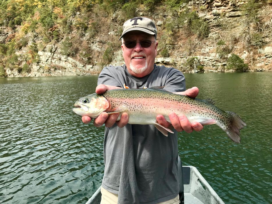 Man with Beard Holding Fish