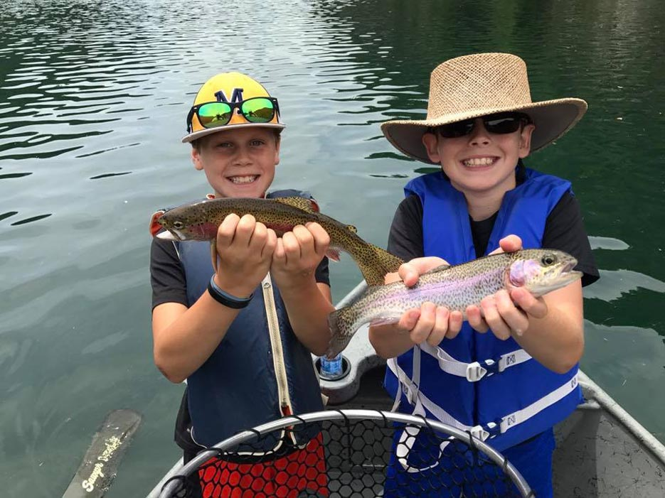 Two Boys Holding Caught Fish