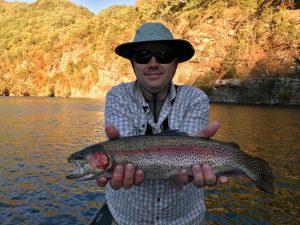 Happy Older Man Holding Large Fish Catch