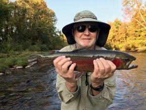 Man Wearing Bucket Hat Holding Fish