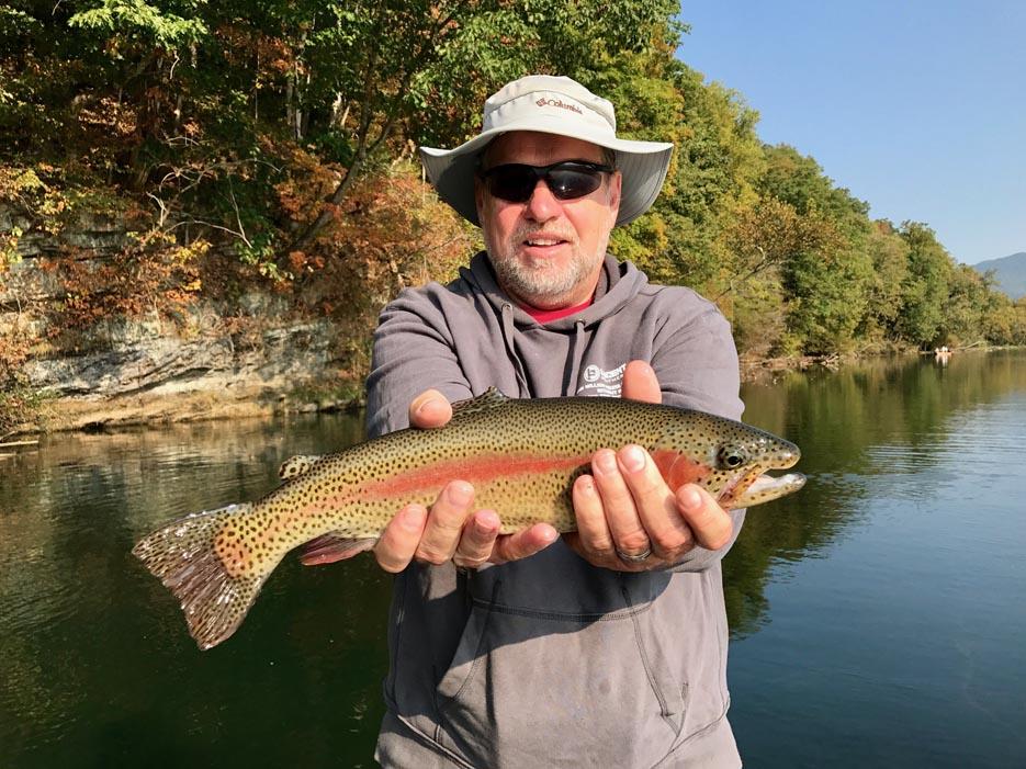 Older Gentleman Holding Fish