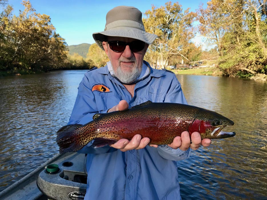 Older Gentleman Holding His Fish